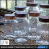 プラスチックふたが付いている円形のメーソンジャーのガラスビン