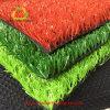 Pista corrente e campo da giuoco dell'erba artificiale di plastica
