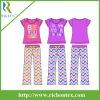 Pijamas cortos ignífugos de la funda de la muchacha fijados