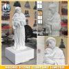 La statua di marmo bianca del bambino e del sacerdote progetta
