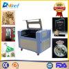 Máquina del grabador del cortador del laser del CO2 del CNC 6090 para el acrílico de madera