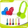 Auscultadores colorido verde das crianças para a música
