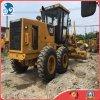 Oruga usada que pavimenta la maquinaria del graduador del gato 140k