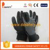 黒いニトリルの手袋Dnn610が付いている伸縮織物