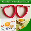 Boucles non-toxiques d'oeufs de silicone de catégorie comestible de forme de coeur de qualité