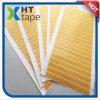 黄色いグラシンリリースペーパーが付いている格子両面テープ