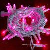 Luz feericamente da luz clara ao ar livre solar cor-de-rosa da corda do Natal da cor