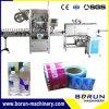 Machine d'étiquetage thermorétractable pour bouteilles