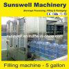 Machine lavant, de remplir et recouvrir 5 gallons