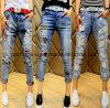 夏の女性Haroun印刷を用いるデニムによって裂かれるジーンズのCropedのズボン