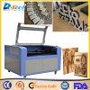 機械を切り分けている中国20mm木CNCレーザーのカッターの二酸化炭素の彫刻家