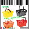 Paniers en plastique modernes de main de supermarché