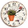 花Deisignが付いている型MDFの柱時計