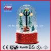 聖歌隊の人形の装飾の雪の薄片のクリスマスの雪の地球