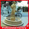 Fontaine d'eau de marbre jaune découpée de femmes
