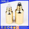 Rolo do petróleo essencial do vidro no frasco com o tampão de parafuso do rolo e do plástico