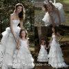 オーガンザの女の子の形式的なガウンの段になった結婚式のフラワー・ガールはF201567に服を着せる