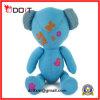 Urso azul do Doodle com bordo e coração