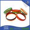 L'abitudine ha stampato il bello braccialetto della gomma di incandescenza del Wristband/del silicone