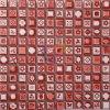 赤い艶をかけられた花模様の陶磁器のモザイク・タイル(CST080)