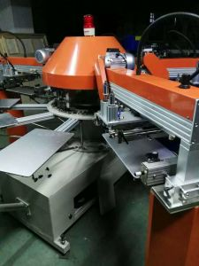Spg-104/8 Series 4 Color Automatic Small T Shirt Screen Printer pictures & photos
