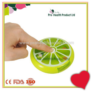 Round Fruit Shape Auto Rotating Push Button Pill Box pictures & photos