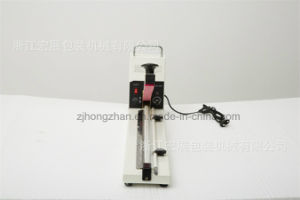 Factory Manufactured Hand Lengthen Impulse Sealing Machine pictures & photos