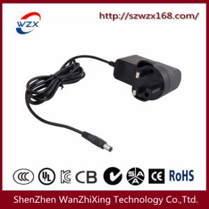 18W Switching Power Supply with UK Plug (WZX-388) pictures & photos