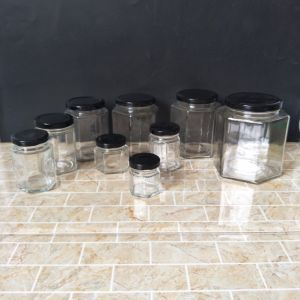 Food Grade 30ml 100ml 200ml 300ml 500ml Hexagonal Glass Food Jar for Honey Jam with Tin Lid pictures & photos