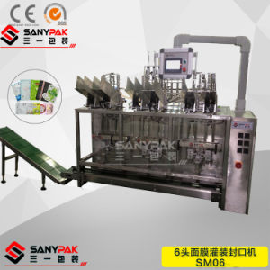 Nonwoven Filling Machine for Face/Eye/Foot Mask with Sealing Printing Function pictures & photos