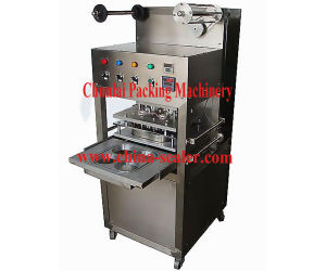 High Production Efficiency Vertical Type Pneumatic Tray Sealing Machine pictures & photos