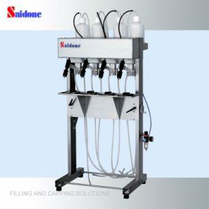 Semi-Automatic Vacuum Filling Machine Vacuum Filler pictures & photos