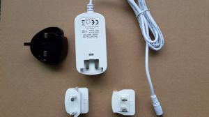 Exchangeable Plugs Power Adapter 12V 0.5A 1A 2A 3A pictures & photos