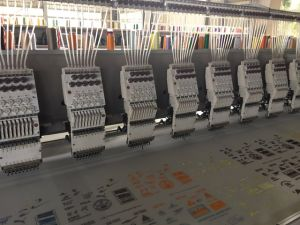 18 Head 9 Colors Flat Embroidery Machine pictures & photos