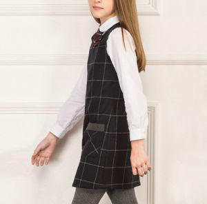 OEM Hot Sale School Uniform One Piece Sleeveless Girl′s Dress with Shirt pictures & photos