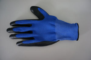 U3 Polyester Shell Nitrile Coated Safety Work Gloves (N1511) pictures & photos