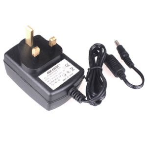 12V 2A Power Adapter with UK Plug Routing Power Supply pictures & photos