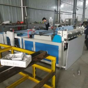 PP Non Woven Texitile Slitting and Cutting Machine with Ultrasonic Weldding pictures & photos