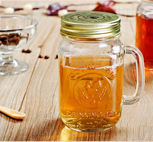 Hot 20 Oz Glass Mason Jar with Handle and Metal Lid pictures & photos
