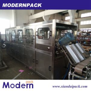 5 Gallons Bottled Water Filling Line/Pure Wate Filling Machine pictures & photos