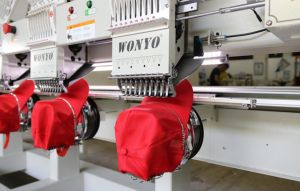 Wonyo Cross Stitch 4 Heads Embroidery Machine for Cap, T-Shirt, and Flat Embroidery Machine with Welcom Software Price pictures & photos