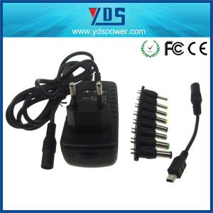 12V 2A Universal EU Wall Plug Adapter with 8 Connector pictures & photos