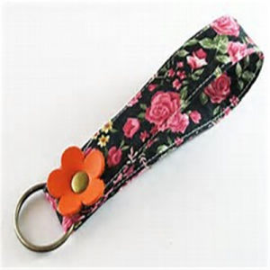Wholesale Customized Fashion Fabric Keyring Doll Diamond Floating Flexible Rubber pictures & photos