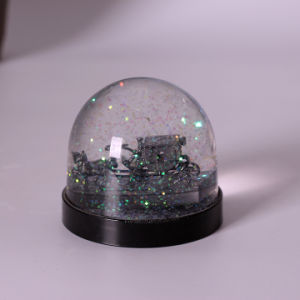 Custom Cheapest Price Plastic Snow Globe Carriage Inside pictures & photos