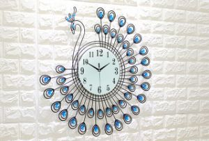 Wall Peacock Clock & Metal Clock & Peacock Metal Wall Clock pictures & photos