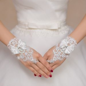 Short Lace Wedding Bridal Gloves with Bow pictures & photos