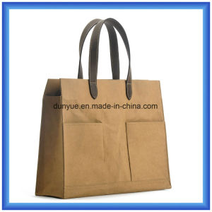 Simple Design New Waterproof Kraft Paper Material Hand Bag, Eco-Friendly Customized Tearproof Special Kraft Paper Handle Carry Tote Bag with PU Leather Handle pictures & photos