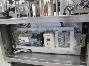 China Low Price High Speed Medical Mask Making Machine pictures & photos