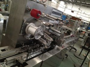 Cellophane Overwrapping Packaging Machinery with Adhesive Tear Tape (SY-1999) pictures & photos