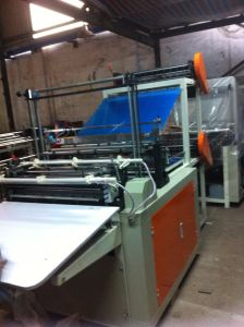 Double Layer Heat Sealing and Cold Cutting Bottom Sealing Bag Making Machine pictures & photos